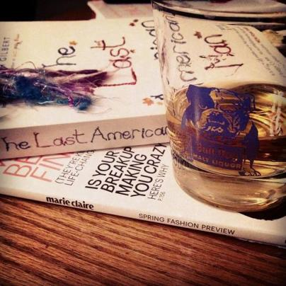 "On a recent Friday night, my husband visited his fam and I opted for a quiet evening in. At one point in the night, I texted him a peak into my evening: fashion mag, the beautiful ""The Last American Man"" by Liz Gilbert, and Laphroaig."